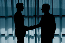 photo of two people shaking hands